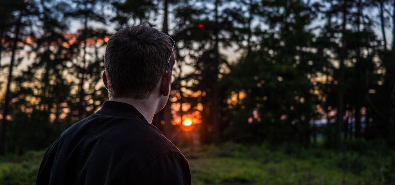 man viewing a sunset